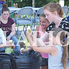 Quiche Matchen/ Daily Clarion  <br /> Jessa Ridao, Leyla Cargal, Abby Gates, and Haley Deisher compete to see who can shuck corn the fastest, prior to the corn-eating contest, Saturday afternoon at the Oakland City Sweet Corn Festival.