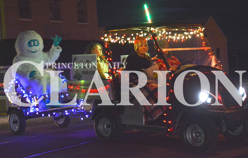 Daily Clarion/Andrea Howe<br /> The Abmominable Snowman got a ride aboard Carts Gone Wild's entry in the Haubstadt golf cart Christmas parade Sunday evening.
