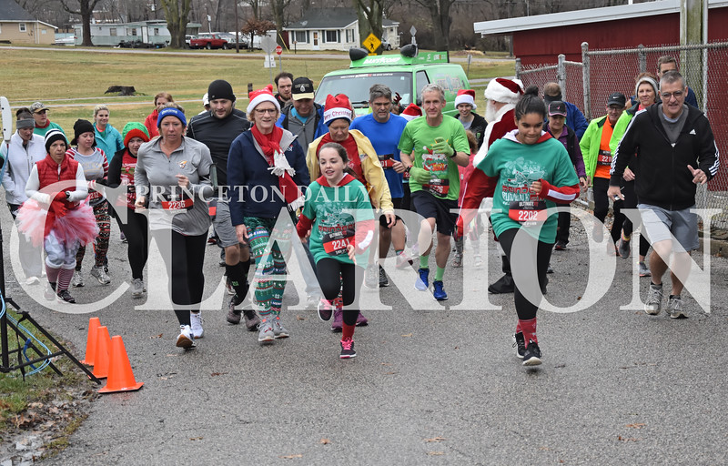 Quiche Matchen/Daily Clarion<br /> Runners and walkers take off for the one-mile walk/run during Gibson General Health Foundation's third annual Reindeer Run Saturday at Lafayette Park.