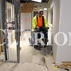 Quiche Matchen/Daily Clarion<br /> Scott Spalding of Danco Construction tears up to flooring in Gibson County Economic Development's Business Center Tuesday afternoon. The center is undergoing renovations and should be complete in the spring of 2019.