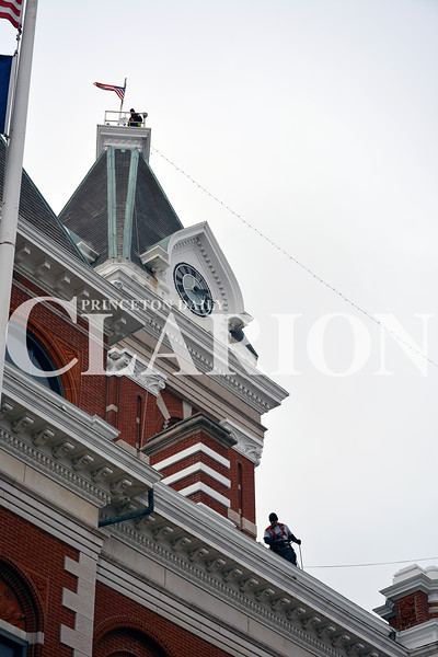 Daily Clarion/Andrea Howe <br /> Princeton Fire Territory crews work Sunday to string Christmas lights from the tip of the clock-tower to the grounds of the Gibson County Courthouse in preparation for the Christmas season. Strands are pulled from the ground level to the roof, then pulled to the clocktower on the southeast quadrant of the square. The lights are traditionally lit at the beginning of the Snowflake Christmas parade, which is Dec. 1.