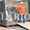 Quiche Matchen/Daily Clarion<br /> Tim Sanders of Danco Construction dumps trash from Gibson County Economic Development's Business Center Tuesday afternoon.