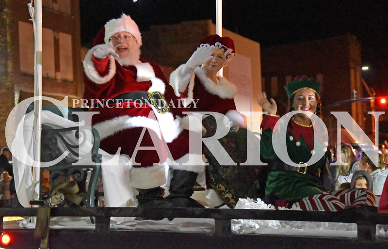 Quiche Matchen/Daily Clarion<br /> Santa and Mrs. Claus wave to the crowd during the annual Snowflake Christmas Parade Saturday night.