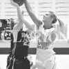 Gibson Southern High School junior forward Maddie Raley rejects a shot by Wood Memorial junior forward Sydney Day during Monday's game.