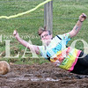Daily Clarion/Andrea Howe<br /> 'Victorious Secret' mud volleyball squad competes in the first round of double-elimination action Sunday night at the Gibson County Fair at the 4-H track.