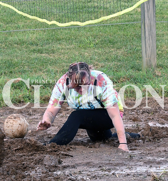 Daily Clarion/Andrea Howe<br /> 'Victorious Secret' mud volleyball squad competes in the first round of double-elimination action Sunday night at the Gibson County Fair at the 4-H track. The fair's Tuesday events include magic shows, wood carving exhibitions, 4-H and open class exhibits and rodeo competition before the grandstand.