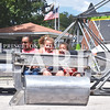 Quiche Matchen/ Daily Clarion archive<br /> Aliyah Wilson, 10, Breanna Wilson, 9 and Matthew Wilson, 7, all laugh and scream as they spin around in the scrambler at the Owensville Watermelon Festival.