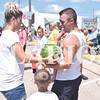 Quiche Matchen/ Daily Clarion archive<br /> Nick John and his son Silas, 5, receive a watermelon during the annual Owensville Watermelon Festival parade.