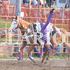 Quiche Matchen/ Daily Clarion  <br /> Annabelle Kindred, 11, shows off her tricks and stunts as she holds onto her horse with one leg, during the rodeo. Kindred has been doing tricks for three years.