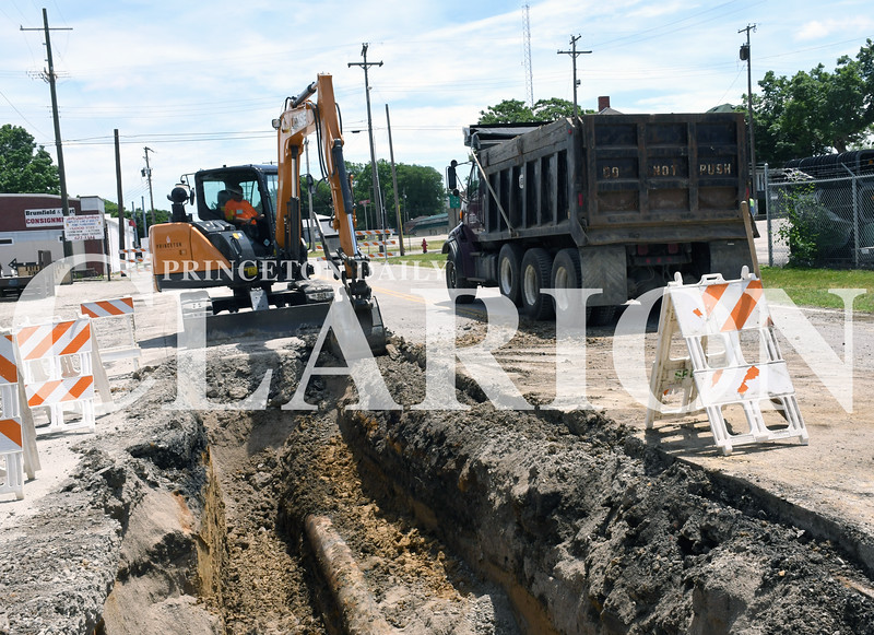 Daily Clarion/Andrea Howe<br /> John Carpenter claws off pavement at the site of a water main replacement project on West Brumfield between Hart and West Streets Tuesday. The section of street will be closed to traffic through the rest of the week until the project is completed. City officials said that once the water line is replaced and the Heritage Trails project is finished, Brumfield will be repaved.