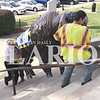 Daily Clarion archive/Andrea Howe  <br /> Gibson County Tourism Commission Executive Director Eric Heidenreich helps Jason Sweeney boost Gibson County's Bicentennial Bison up the steps of the south side of the Gibson County Courthouse while Brandon Burton carries the front end of the fiberglass sculpture.