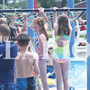 Quiche Matchen/ Daily Clarion <br /> Kids at the Princeton Aquatic Center wait in line to slip and slide while crossing the lilly pads, Tuesday afternoon. Swimmers enjoy the second day of the aquatic center being open, before rain showers pour in.