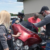 Daily Clarion/Andrea Howe<br /> Oakland City Chapter Road Riders for Jesus President Alan Brock, second from left, prays over a bike with chapter members and Troy Willis of the Rolling Disciples motorcycle group Sunday afternoon at Oasis Assembly of God's Bike Sunday event.