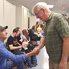 "Quiche Matchen/ Daily Clarion <br /> Cecil ""Bob"" Allen shakes Larry Wire's hand after finding out he won the Democrat nomination for Gibson County Commissioner District 1 Tuesday night."