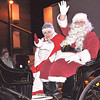 Quiche Matchen/Daily Clarion archive<br /> Santa and Mrs. Claus wave to the attendees of the Snowflake parade.