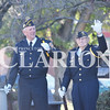 Quiche Matchen/ Daily Clarion archive<br /> <br /> John Moore and Charles Montgomery raise their hands as their branch of service is called out at the Veterans Day celebration at the courthouse gazebo.