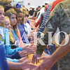 Quiche Matchen/ Daily Clarion archive<br /> <br /> Princeton Community Intermediate School students touch hands with veterans, who attended their Veterans Day program, as they did their walk of fame.