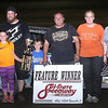 Photo provided by Samantha Beadles. Stan and Samantha Beadles pictured with family at Tri-State Speedway.