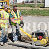 Sarah Loesch/Daily Clarion James Mattingly and Ted Brown, with RiverTown Construction, work on the sidewalk project on Franklin Street in Oakland City.