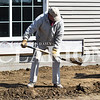 Sarah Loesch/Daily Clarion David Lutz, a volunteer with the Gibson County Habitat for Humanity, shovels dirt Monday afternoon at the newest home site on Madison Street in Princeton.