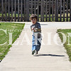 Sarah Loesch/Daily Clarion Gunner Munro, 3, races down the sidewalk Wednesday afternoon at the Fort Branch-Johnson Township Public Library. Munro enjoyed a picnic with his mom and sister out on the lawn before heading inside for crafts and books.