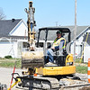 Sarah Loesch/Daily Clarion Don Anderson places gravel Tuesday afternoon on Franklin Street in Oakland City. RiverTown Construction is currently working on one side of Franklin's sidewalks from College Street down to the water tower.