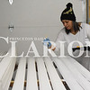 Sarah Loesch/Daily Clarion Amanda Madison paints trim for the inside of the latest Gibson County Habitat for Humanity home Monday morning in Princeton. Madison and her family will move into the home after its completion, which could be as early as May.