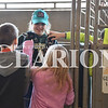 Sarah Loesch/Daily Clarion Emma Robling holds up two pygmy goats for students from Oakaland City Elementary to pet Wednesday morning at the Gibson County Fairgrounds. Sudents from around the county spent their day at the 2019 Fourth Grade Farm Fair sponsored by the Gibson County SWCD, Gibson County Farm Service Agency and Purdue Extension of Gibson County.