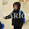Sarah Loesch/Daily Clarion Daniel Williams shows off some art in the hallway at St. Joseph Catholic School during Thursday night's open house. Daniel and his brother Andrew are currently in pre-school and their older sister Joanna attended before them.