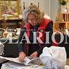 Sarah Loesch/Daily Clarion Niki Larson wraps up items for a customer Saturday morning during the Collectors Carnival Antique & Flea Market at the Gibson County Fairgrounds. Niki and David Larson had their booth set up with a variety of items to choose from. Niki said there isn't a direct theme to the items they have, but that anything anyone is looking for they just might have.
