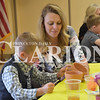 Sarah Loesch/Daily Clarion Ryder Brengman and his mom Adrienne Brengman work on a flower pot for his grandma Paula Troutman Friday morning.