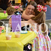 Sarah Loesch/Daily Clarion Addison Hudson wraps her mom Autumn Hudson in a hug Friday morning during the St. Joseph Catholic School Pre-K Mother's Day Tea. Addison had just presented her mom with a hand-painted birdhouse.