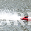 Madison Brooks/Daily Clarion Terry Easton's Traxxas M41 Wide Body remote controlled boat races across Lafayette Park pond on Tuesday afternoon.