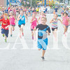 Young runners zip through the opening stages of Saturday's Owensville Watermelon Festival Fun Run.