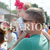 Parade<br /> Daily Clarion/John Roark<br /> Adelyn Brown, 6 months, Salem, watches Saturday morning's Owensville Watermelon Festival parade while on the shoulders of her father, Matt Brown.