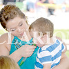 Daily Clarion/John Roark<br /> Hailey Groves shares a popsicle with her son, Blayne Roark, during Saturday morning's Owensville 103rd annual Watermelon Festival.
