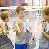 """Tayton Torres (left) Landon Shoemaker (center) and Trenton Torres (right) pick up backpacks filled with school supplies Monday afternoon at the Salvation Army in Princeton. They also brought along pet lizards. The Salvation Army  """"Tools for School"""" program distributes backpacks filled with basic school supply needs for students from grades K-12. Sign-up and distribution is from 9-11:30 a.m. and 1-3 p.m. Aug. 1-3 at the church, located at Water and South Gibson Streets in Princeton. For more information, contact The Salvation Army at 812-386-6577."""