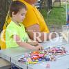 Daily Clarion/John Roark<br /> Kealin Seger-King, Jasper, checks his haul of parade candy during Saturday morning's Owensville Watermelon Festival.