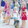 Daily Clarion/John Roark<br /> Youngsters eagerly await their chance to grab some candy during Saturday's 103rd annual Owensville Watermelon Festival.