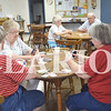 Phyllis Lauderback, Judy Stock and Dianna Skelton enjoy playing phase 10, a card game, Wednesday afternoon at the Gibson County Senior Center. Cargill Wilson and Barbara Singleton Wilson play card game, kings in the corner, not far from the group of women.