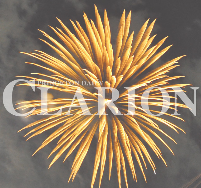 Daily Clarion/Andrea Howe<br /> Fair fireworks<br /> Princeton Area Betterment's traditional Independence Day fireworks display postponed by wet weather July 4, lights the sky above the Gibson County Fairgrounds Friday night.