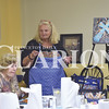 Several locals came out to An Evening of Art to create a masterpiece with Dr. Deanna King at R'z Cafe in Fort Branch Thursday night. King explains how the group will create the masterpiece and how they are there to have fun.