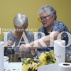 Carol Shoulders helps her mother Jean Shoulders with her artwork Thursday night at R'z Cafe in Fort Branch.
