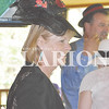 Daily Clarion/Andrea Howe Gibson County Chamber of Commerce Executive Director Karen Thompson sports a spectator hat at the chamber's first Derby Day mixer on the veranda at The Azalea Path, celebrating some of the traditions of the Kentucky Derby, Hoosier style.
