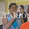 Rachael Emberson, 13, tries different carrots that the food science frenzy class cut and boiled Wednesday morning. The class learned the difference between canned, fresh and other carrots.