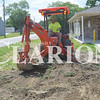 Brandon Epple of Epple Construction and Excavation of Haubstadt finishes grading to drain and stop flooding in front of the Gibson County Habitat for Humanity headquarters Tuesday afternoon. The construction company donated time and equipment for the project.