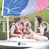 YMCA Camp Carson counselors Carly Razny, Katie Healy and Haley Cobb train on a sail boat Thursday morning in preparation for opening day next week.