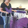 """Daily Clarion/Andrea Howe<br /> Heather Burress found the Gibson County Relay for Life purple butterfly at the office of Princeton Publishing Friday in the """"Paint the Town Purple"""" scavenger hunt in progress through June 4. The local fundraiser event for the American Cancer Society is Saturday at the Gibson County Fairgrounds pavilion."""