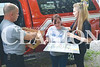 "Princeton Fire Territory Chief Mike Pflug presents Julia Aregood and her daughter Kaylor Carney with family portraits archived from Noelle K Photography Friday afternoon. The Aregoods lost many of their possesions in a house fire April 22. ""Photographs are a mother's precious gift,"" Aregood said."