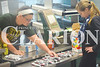 Hannah Reising  and Kiersten Bottoms count Fruit Roll-ups for concessions at the academic bowl Saturday afternoon.